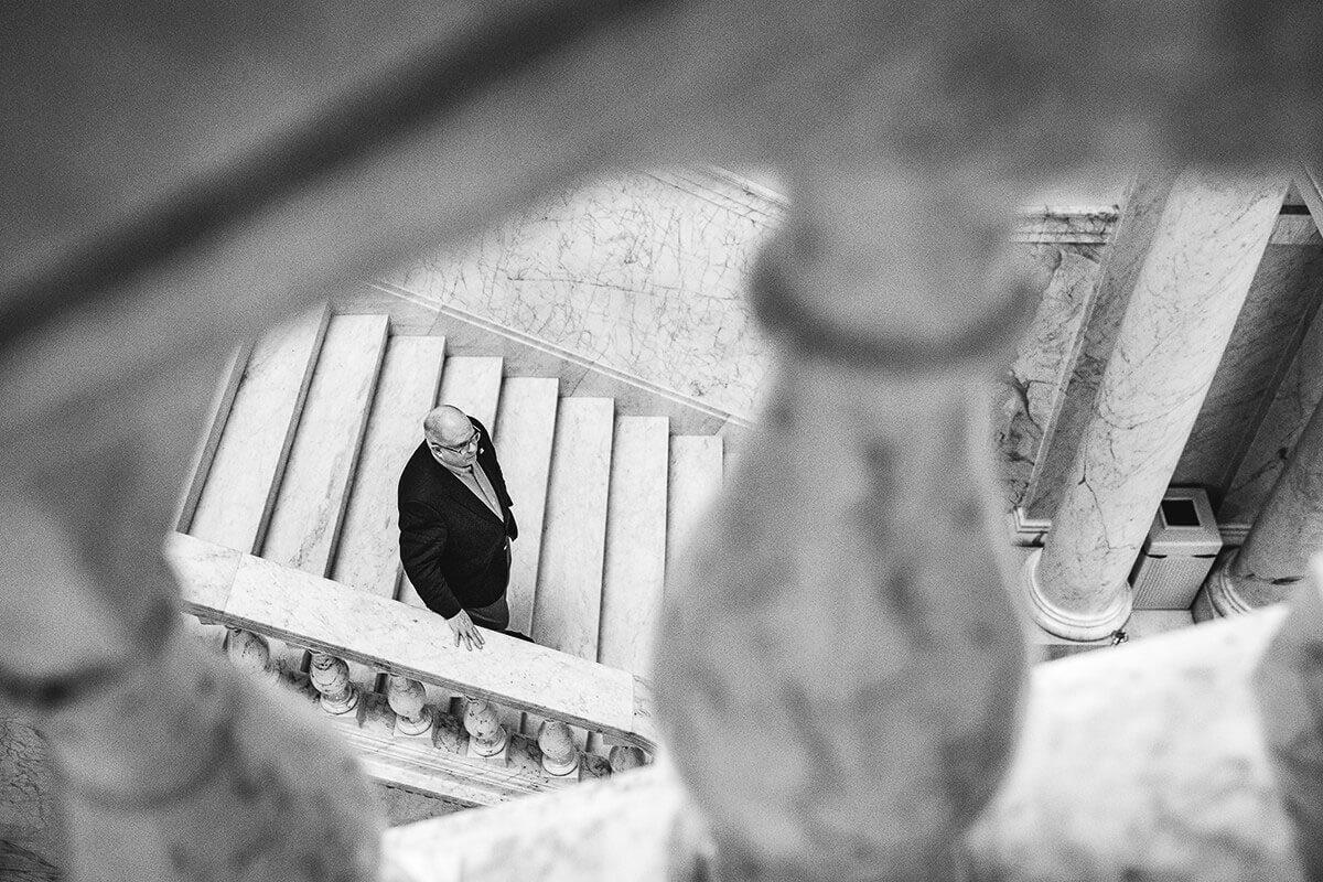 A picture Larry Hogan descending the staircase at the the state house.