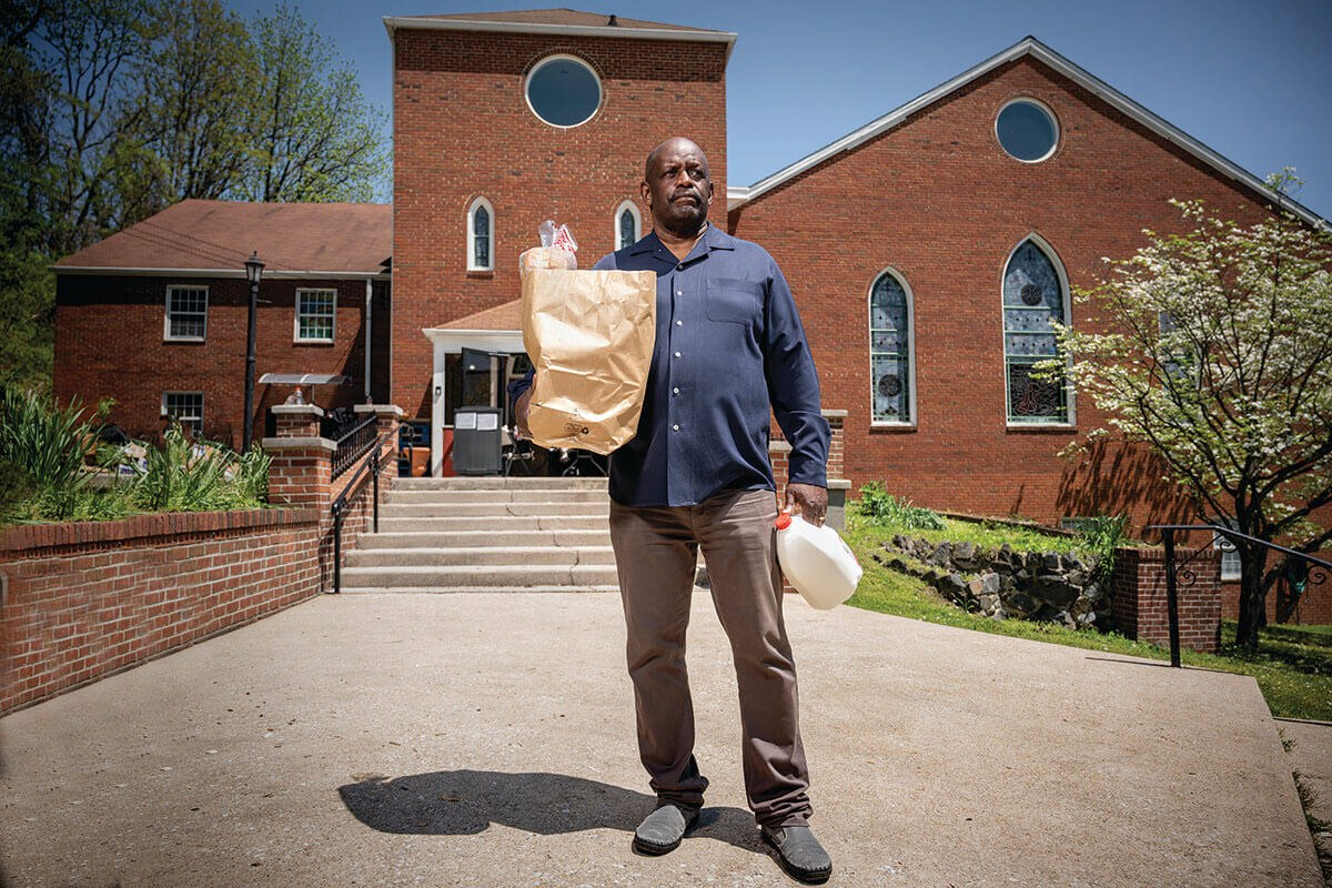A picture of Pastor Michael Martin delivering groceries.