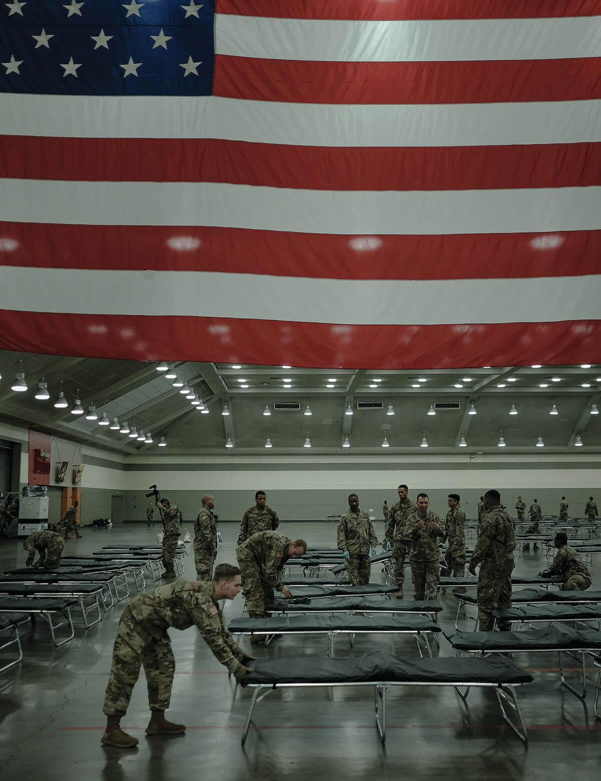 A picture of the National Guard as they Set Up a Field Hospital in the Baltimore Convention Center.