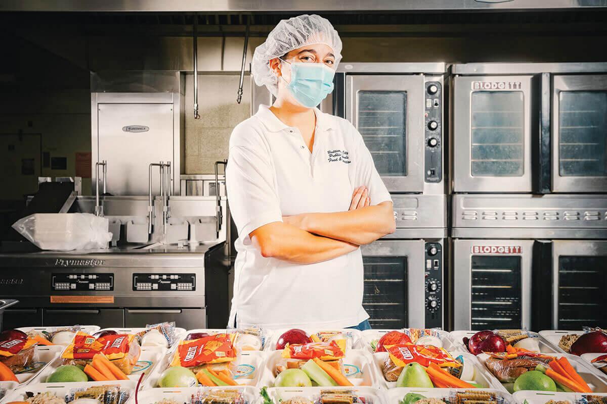 A picture Elizabeth Marchetta preparing meals for children after the schools shut down.