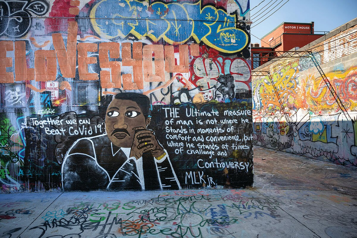 A picture of Graffiti Alley with a Martin Luther King Jr. quote painted on the wall.