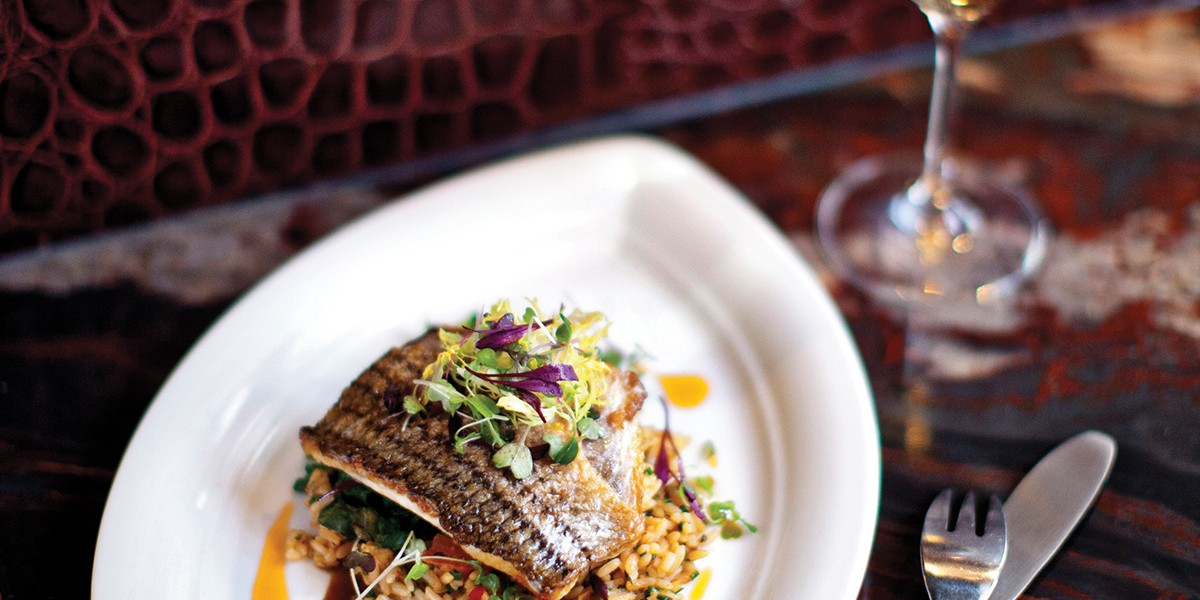 """B&O American Brasserie: """"rockfish could pass as red meat, dense with red-wine sauce and served with pumpkin-seed risotto and crispy broccoli raab.""""Scott Suchman"""