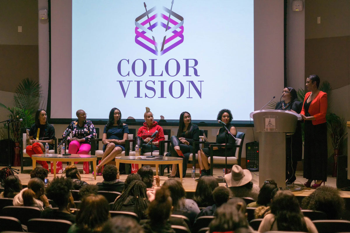 Mia J. Davis and Thea Washington hosting a panel discussion at their first event at Morgan State University.Color Vision