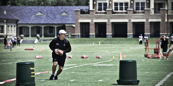 Harbaugh on the field during practice at the Ravens' training facility in Owings Mills.Photography by Daniel Bedell
