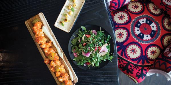 Nashville cauliflower, deviled turnips, and a salad at Encantada.Christopher Myers
