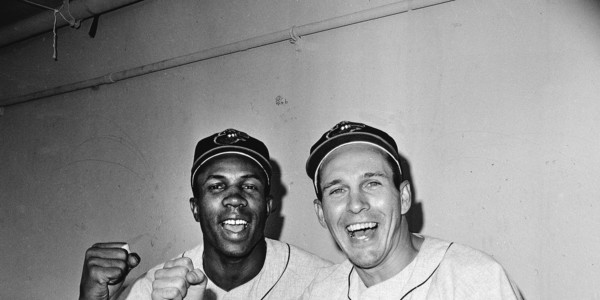 Frank Robinson, left, and Brooks Robinson pose victoriously after the Orioles to a 5-2 win against the Los Angeles Dodgers in Game 1 of the 1966 World Series.AP