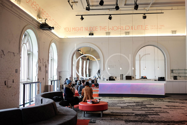 The Deering Lounge, outside the Head Theatre, which boasts a high-ceiling and luminous windows that had formerly been covered over with heavy curtains.Photography by Meredith Herzing