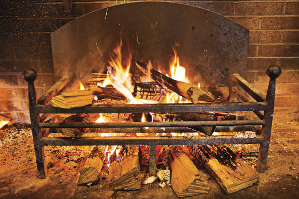"The wood-fired hearth at Parts & Labor, which is featuring ""snowed-in"" specials at its butcher shop.Photography by Scott Suchman"