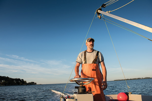 Tim Devine on the bay aboard Paul's Old Boat. Photography by Mike Morgan
