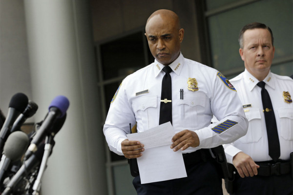 Anthony Batts, left, and Kevin Davis at a 2015 press conference outside Baltimore Police headquarters.Associated Press