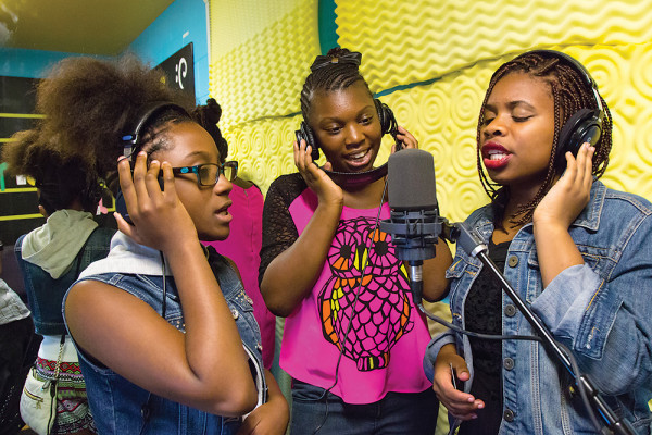 """Left to right: Taniyah, Amira, and Yamaudi record vocals to """"Believe in Baltimore.""""Photography by Sean Scheidt"""