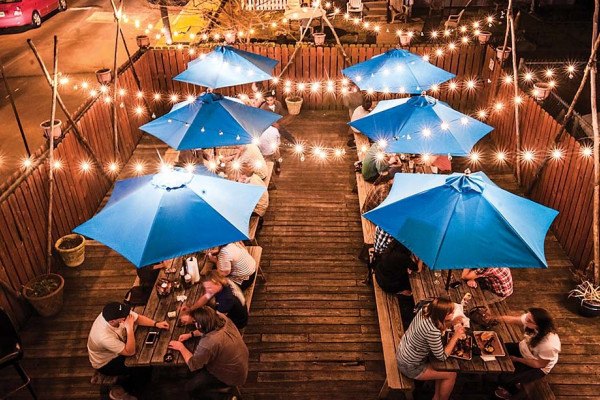 The patio at Blue Pit BBQ & Whiskey Bar.Photography by Kathryn Dulny