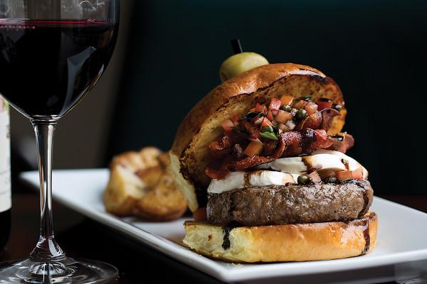 Burger with prosciutto and mozzarella. Photo by Ryan Lavine