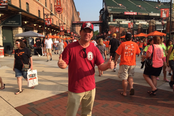 Chuck Booth on Eutaw Street at Camden Yards, one of his many stops this summer.Photography by Corey McLaughlin