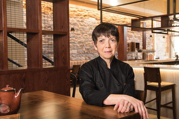 Donna Crivello sits inside her new space at Cosima in  Mill No. 1.Photography by Mike Morgan