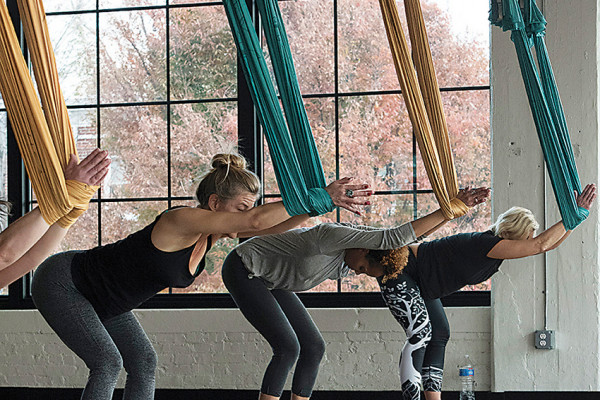 Stretching with silk hammocks during an anti-gravity yoga class at Movement Lab.Photography by David Colwell