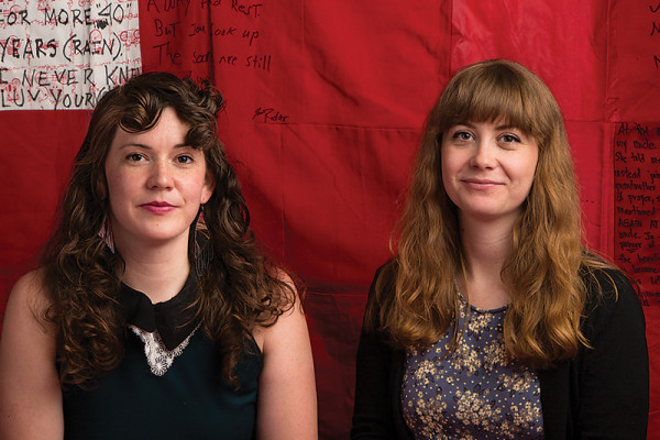 FORCE co-founders Rebecca Nagle, left, and Hannah Brancato in front of The Monument Quilt.Photography By Sean Scheidt