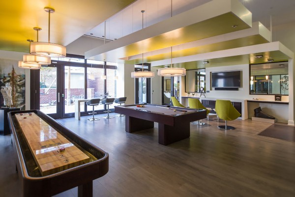 Game Room with video console, billiards, darts, and shuffleboard.Jefferson Square Apartments