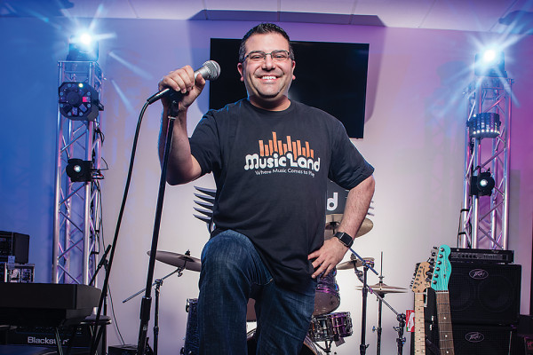 Larry Noto on the new stage at Music Land, his music store in Bel Air.Photography by Mike Morgan