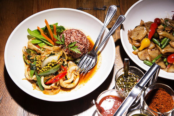 Fried squid with chili paste and drunken noodles with chicken.Photography by Scott Suchman