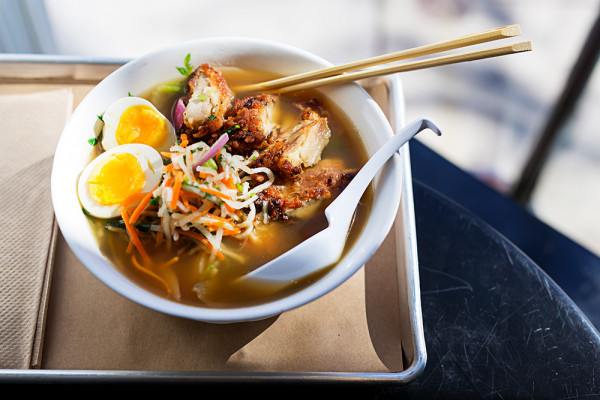 Ramen topped with fried chicken.Photography by Scott Suchman