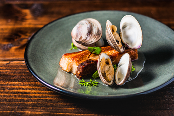 Braised pork jowl and Littleneck clams by chef Wilbur Cox.Courtesy of Hotel Revival