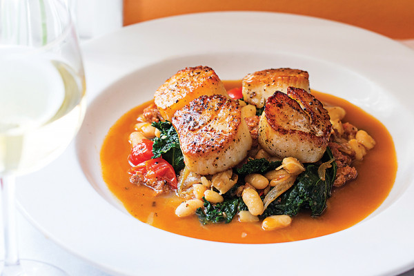 Pan-seared scallops with bean ragout. Photography by Scott Suchman