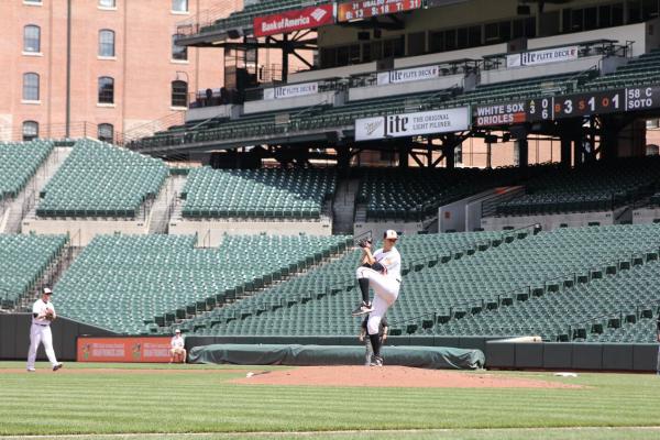 Starting pitcher Ubaldo Jimenez winds up to start the game.Photography by Meredith Herzing