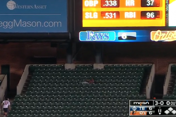 A fan's nap is interrupted by a Chris Davis bomb to center field.MLB.com