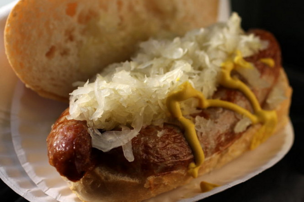 A brat with sauerkraut and mustard from Frank's Bratwurst stand at the West Side Market.Cleveland.com