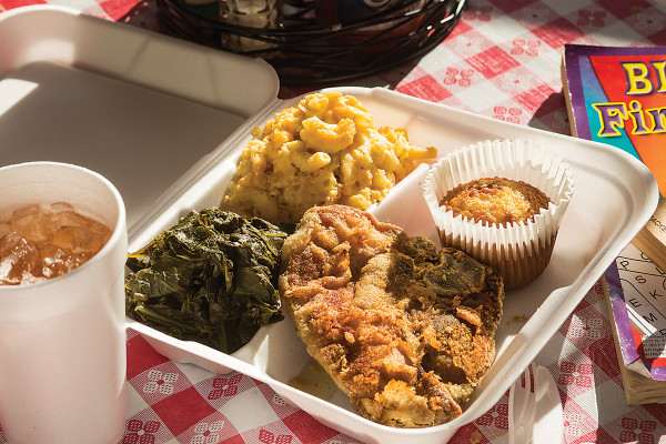 "An ""Everyday Meal"" with a fried pork chop from Georgia Soul Food.Photography by Ryan Lavine"