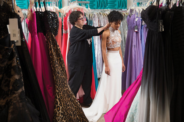 Karen Mazer helps a client at her shop, Synchronicity Boutique in Pikesville.Photography by David Colwell