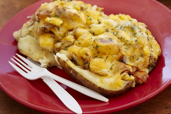 Baked potato with crab, shrimp, and mac and cheese. Photography by Scott Suchman