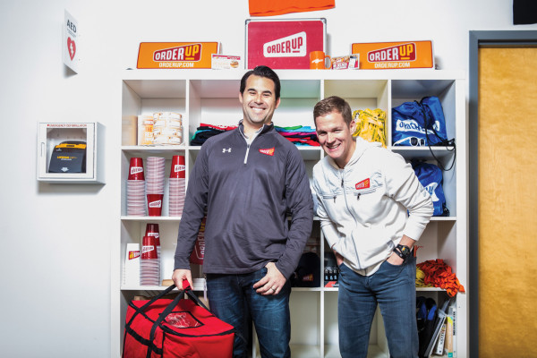 Jason Kwicien, left, and Chris Jeffery pose with Order Up swag.Photography by Brian Schneider