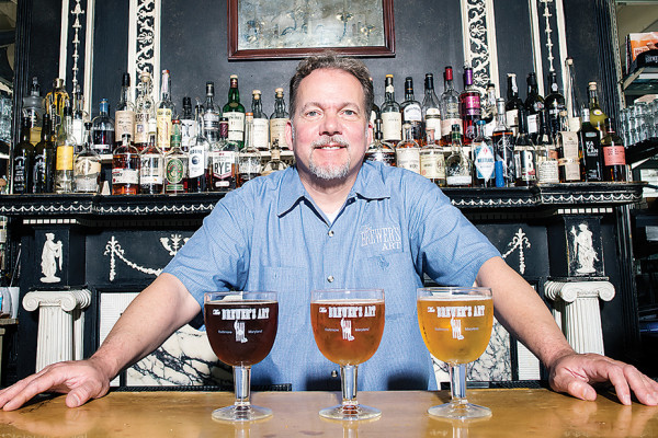 Volker Stewart with his beloved Belgian ales.Photography by Christopher Myers