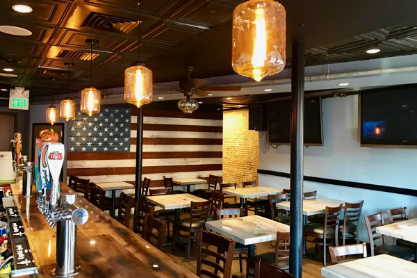 The rebranded space boasts a new interior with updated furniture, artwork, and bartops. Courtesy of Victor Acosta