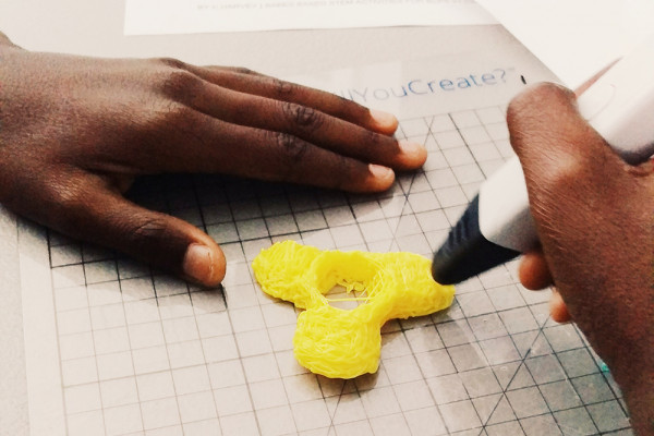 A student working on a fidget spinner.Open Works