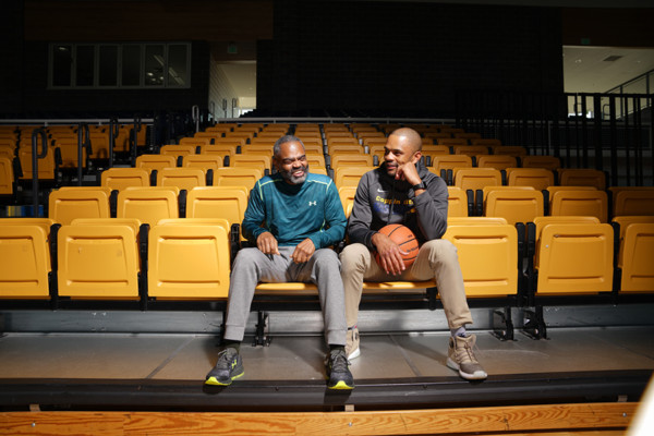 Bruce Flanigan, left, and son Juan Dixon together at Coppin State University.Brian Schneider