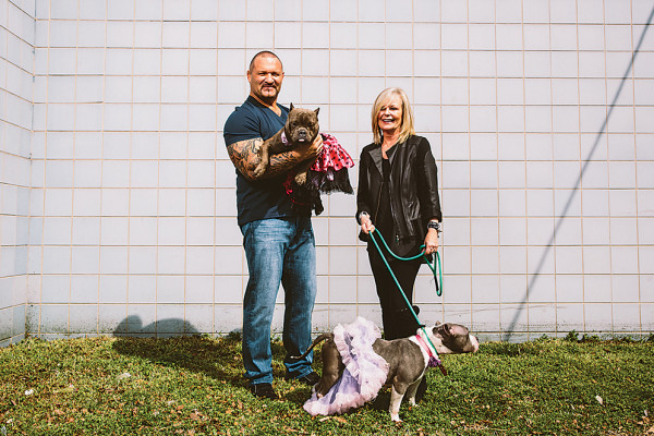MMA fighter John Rallo and Sande Riesett pose with some furry friends.Photography by Brian Schneider
