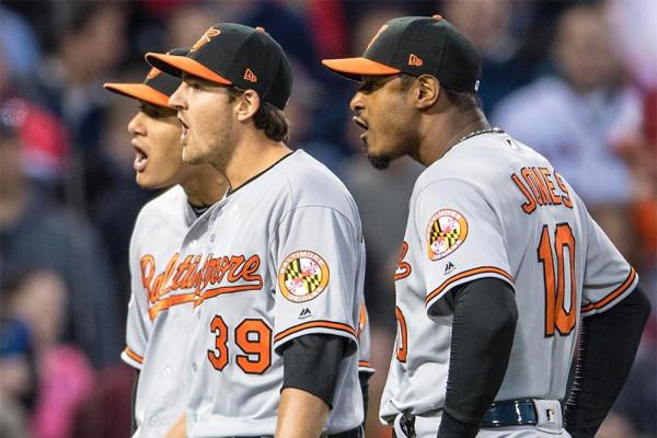 Manny Machado, Kevin Gausman, and Adam Jones react in Wednesday night's game.MASN