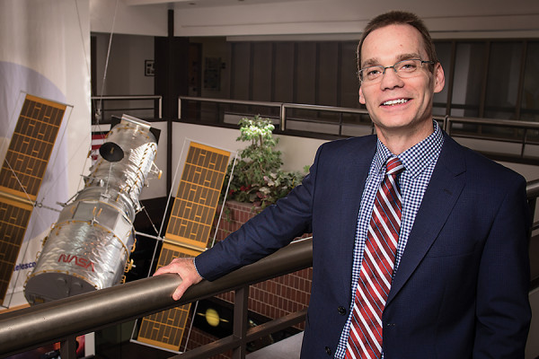 Kenneth Sembach at STScI, in front of a model of the Hubble Space Telescope.Photography by Mike Morgan