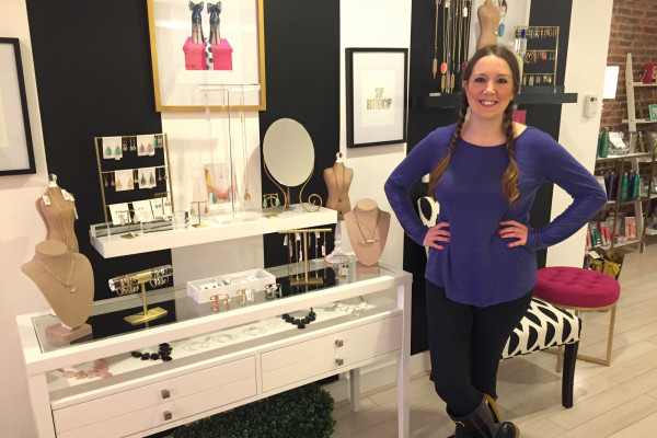 Cydney Vigliotti poses inside her Federal Hill boutique, Punch.Photography by Kelsey Bray
